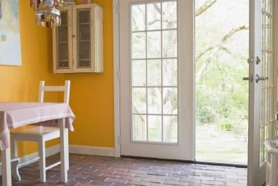 Sliding glass doors fill a room with appealing natural light, but their contemporary appearance looks out of place in a traditional home. You can easily spruce up your sliding doors to resemble ...