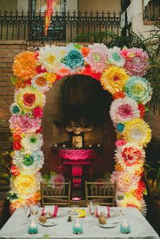 Blome's Paperie - Modern Mexican Wedding. I love the arch of huge colorful flowers!