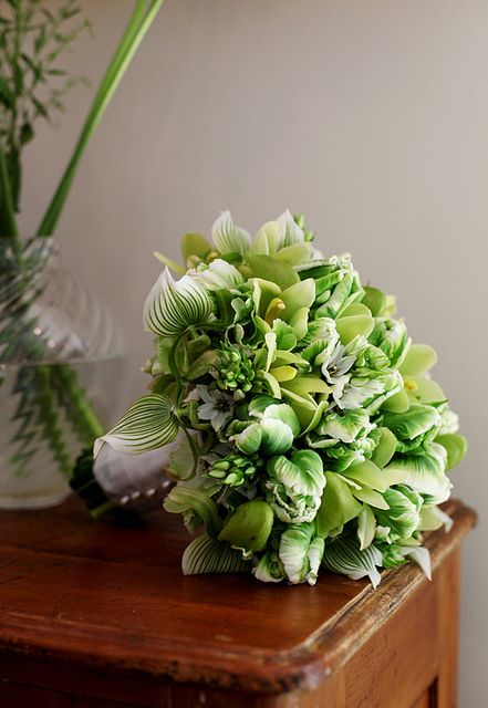 Wow....gorgeous in green!  Looks like Lady's slipper orchids, parrot Tulips, Ornithogalum, Cymbidium orchids...not sure if I missed anything.  Nice work!