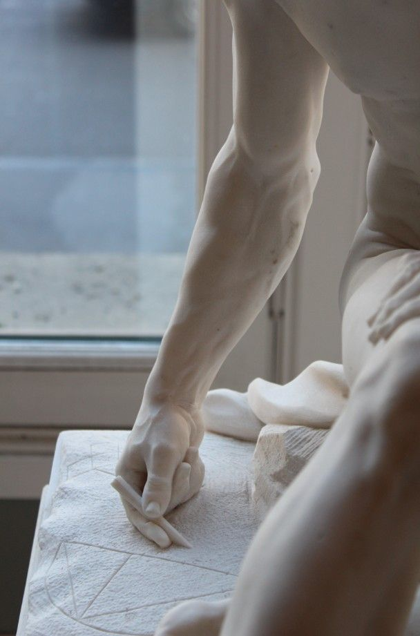 Marble sculpture has always awed me.  They really do look like one of those living statues.  So beautiful.  :)