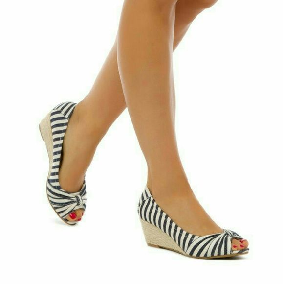 Nautical wedge Buy $13 Trade $25 These are so cute with boyfriend jeans & boyfriend t. So cute & so comfty Life Stride Shoes Wedges