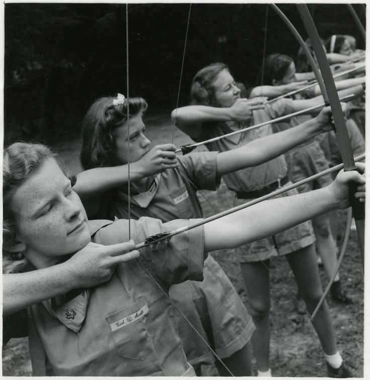Girls learning archery at a 1930s Girl Scout Camp.  Archery was a skill that many Girl Scouts learned at camp, and it is still a part of camp activities today.