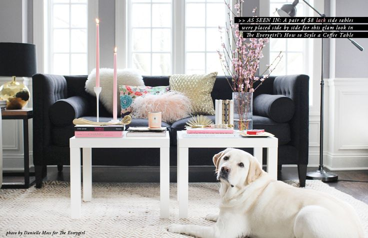 Ikea lack side tables in white look stylish with colorful accessories ion top of an off-white rug and in front of a dark grey sofa. The room has a great balance of colors and the various heights of furniture all somehow balance each other out for a great visual flow and culminate in the visual pop of the couch pillows and coffee table styling. The cute pup doesn't hurt either.