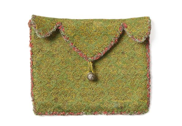 Knitted silk purse, probably Italian circa 1550 CE. The body was knitted in stockinette, and the edges finished with purl. Accession Number: SHM.2010.T1 The Simone Handbag Museum, Korea.