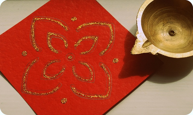 Dussehra / Diwali decorating ideas, via Flickr.  Construction paper and glitter. You can also use small red squares and hang them as a garland.