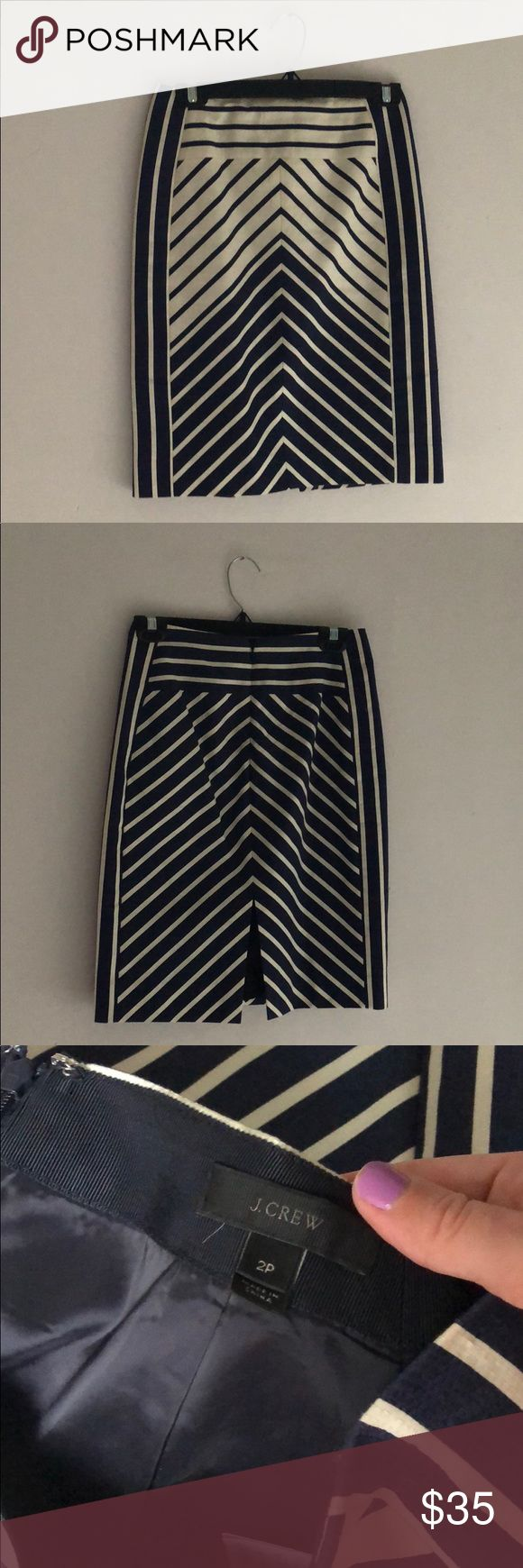 """ J Crew. navy chevron pencil skirt ✏️ Worn once and in perfect condition. Size 2p This sleek, slightly longer silhouette with a modern higher waist. It's made from a specially stitched cotton fabric, so it has a touch of texture, and is finished with chevron stripes that were carefully engineered for an extra-flattering effect. Cotton. Back zip. Lined. Dry clean. Import. Online only. Item C5408. Sits above waist. 21 1/4"""" long. Falls above knee J. Crew Skirts Pencil"""