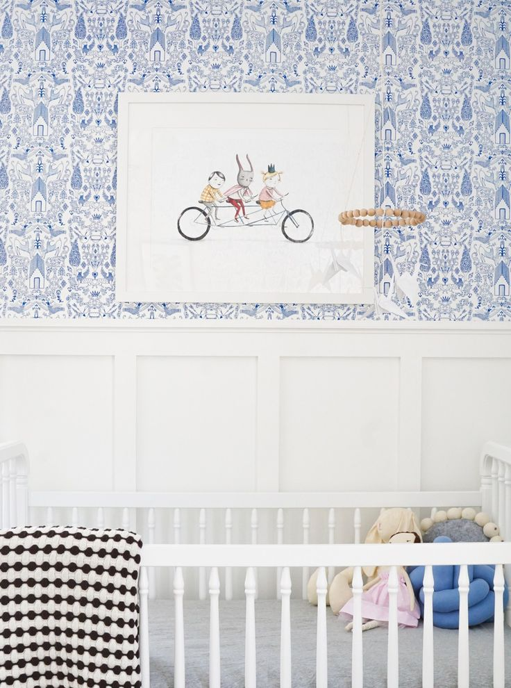 White gallery frame on beautiful blue wallpaper