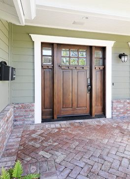 Craftsman door with double sidelights - I like the white frame and darker door.  We could do this two-tone throughout the house maintaining the door color on the floor and the white for trim, cabinets, banister (top rail of banister dark like foor).