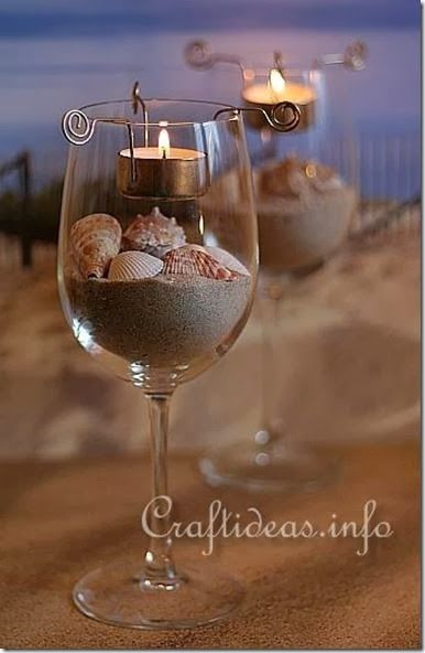DIY Centerpiece idea - buy inexpensive wine glasses, fill them with with whatever makes sense for your theme!