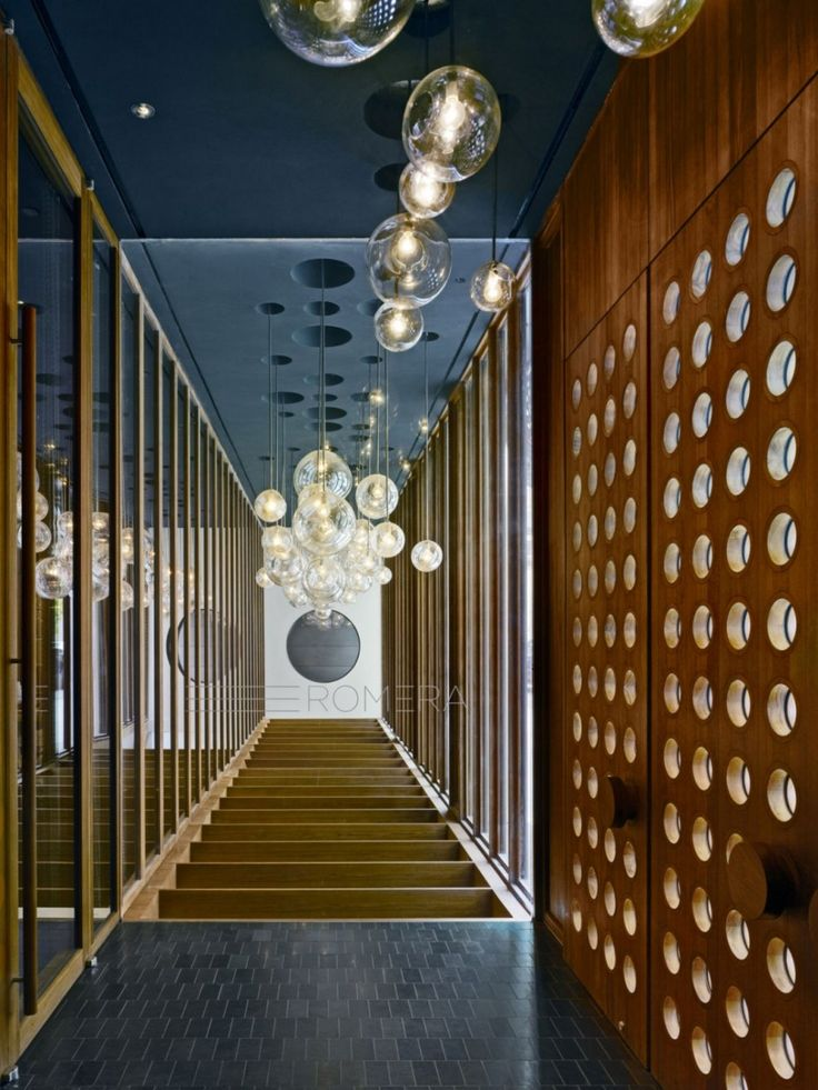 interesting wood panel effect on wall, mirrors reflect lighting - this is too much but elements of it are great -Dream Downtown Hotel by Handel Architects