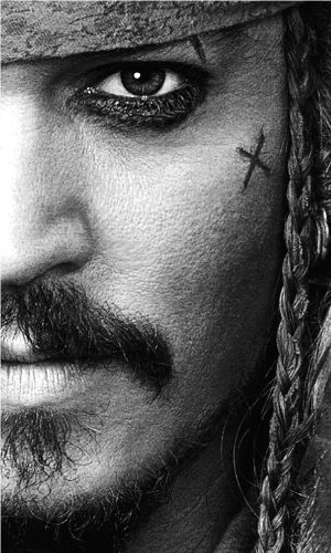 "Johnny Depp as ""Captain"" Jack Sparrow."