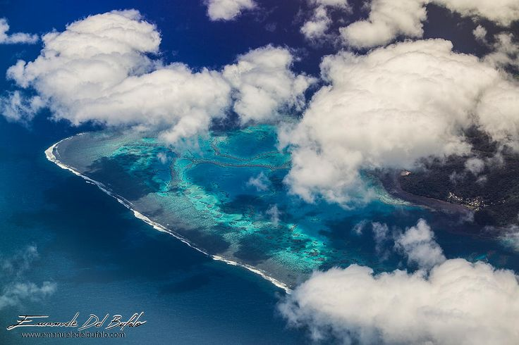 A shot taken from the plane to Viti Levu, Fiji. Fiji Islands - Photo by Emanuele Del Bufalo www.emanueledelbufalo.com From this height the contrasts between the blue ocean water and the colors of the lagoons and small coral reefs surrounding the islands create spectacular scenery.