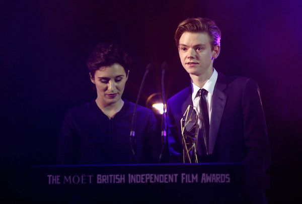 Thomas Brodie-Sangster Photos Photos - (L-R) Presenters Vicky McClure and Thomas Brodie-Sangster attend The Moet British Independent Film Awards 2015 at Old Billingsgate Market on December 6, 2015 in London, England. - The Moet British Independent Film Awards 2015 - Awards