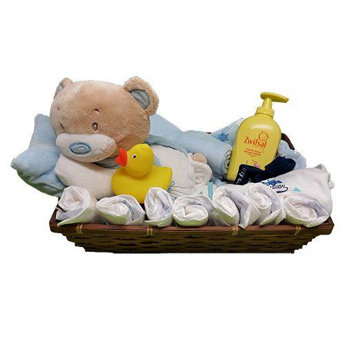 Quality Fruit Baskets. Mand liggende Beer jongen  1x beer liggend op blauw kussen  8x luier  1x bad eend  1x Zwitsal  crème zeep 300 ml.  1x Pyjama