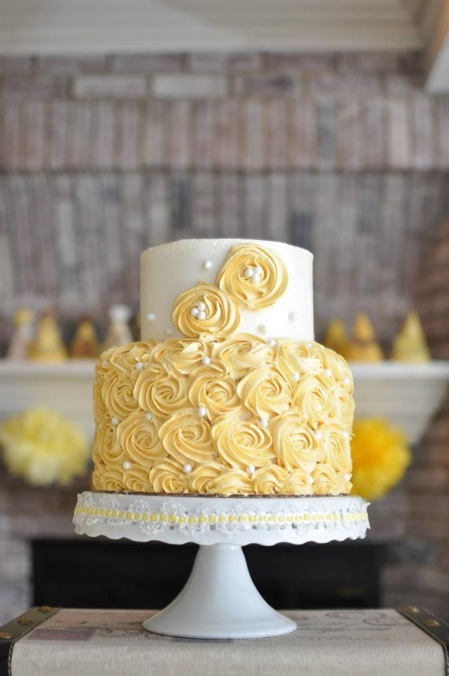 vintage look buttercream tiered cakes | Yellow vintage style cake covered in buttercream rosettes. For more ...