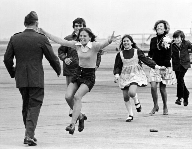 Released prisoner of war Lt. Col. Robert L. Stirm is greeted by his family at Travis Air Force Base in Fairfield, Calif., as he returns home from the Vietnam War, March 17, 1973.  In the lead is Stirm's daughter Lori, 15; followed by son Robert, 14; daughter Cynthia, 11; wife Loretta and son Roger, 12.  / Credit: AP Photo/Sal Veder