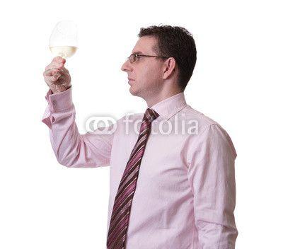 Man tasting a glass of white wine