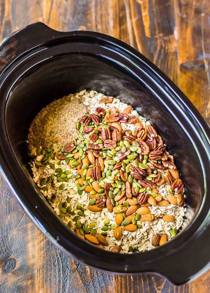Easy Crock Pot Granola. Let the slow cooker do the work! A simple, healthy granola recipe made with oatmeal, nuts, fruits, and maple syrup or honey. @wellplated