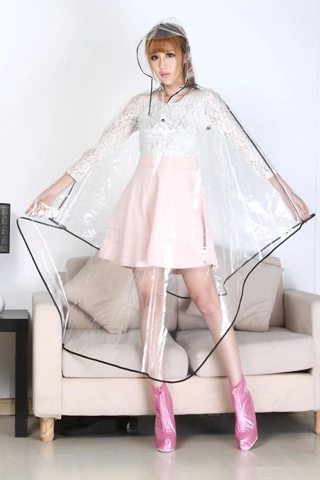 Women's clear vinyl poncho-style raincoat with black trim worn over pink skater skirt and white lace top.. DIY the look yourself: http://mjtrends.com/pins.php?name=clear-vinyl-for-poncho