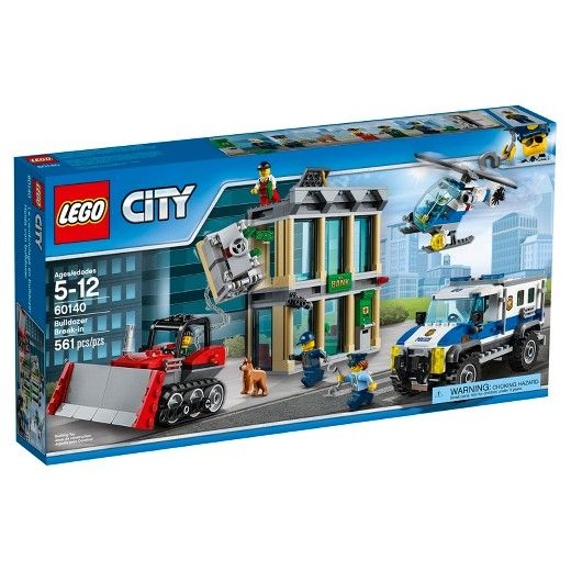 LEGO® City Police Bulldozer Break-in 60140:<br>Protect the bank and stop the crooks! Use the police helicopter and truck to stop the crooks from ripping out the bank safe and ATM, featuring a bulldozer, accessory elements, five minifigures and a police dog figure. Be part of the action with the LEGO® City police as they protect the bank's safe and ATM from the crooks and their bulldozer, with a high security truck loaded with accessories, helicopter with sear...