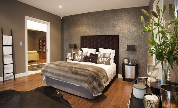 A mix of texture and dramatic feature wallpaper give this bedroom an opulent finish.