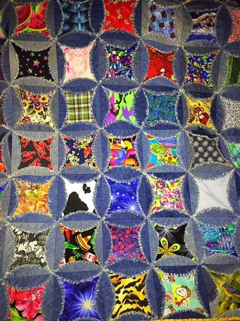 My husband had a stack of old jeans that were just taking up space so I decided to make them into a quilt.  This is an I Spy quilt, all the fabrics are differen…