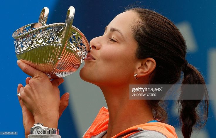 Ana Ivanovic of Serbia kisses the Maud Watson trophy after beating Barbora Zahlavova Strycova of Czech Republic in the final of the WTA AEGON Classic tennis tournament at Edgbaston Priory Club, Birmingham, central England, on June 15, 2014.