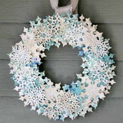 Love this wreath too. Great idea for all that unused scrapbook paper! From GoodHousekeeping 10 Enchanting Winter Wreaths to Make