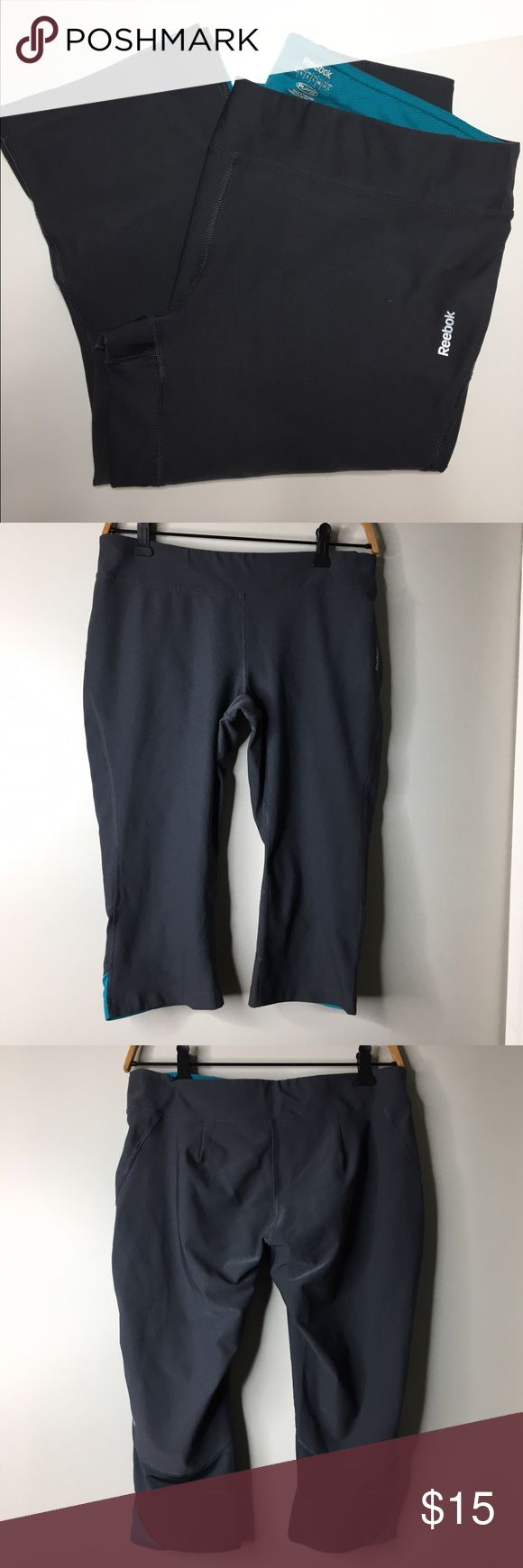 Reebok dark gray workout capris Pre-owned, like new dark gray Reebok workout Capri pants. Some of the pictures look black, but they are dark gray with blue accents. Size large. Reebok Pants Capris