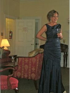 Holiday dresses for women over 40: This floor-length midnight blue ruched gown is perfect for a holiday party of formal gala.