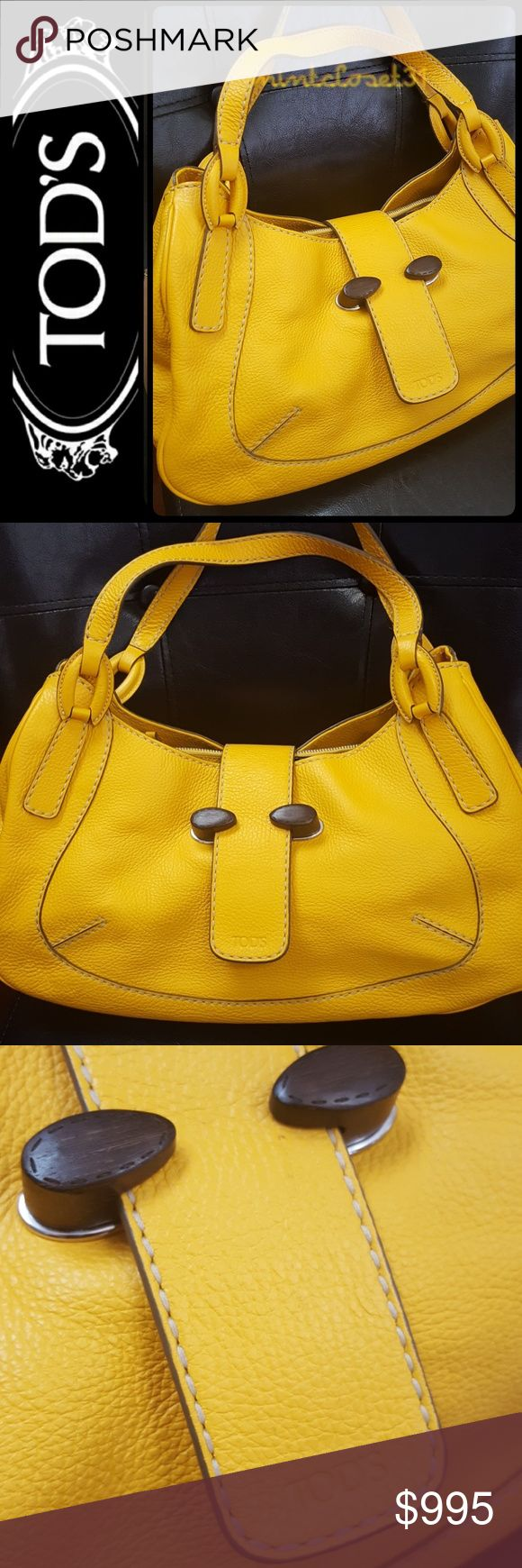 Tod's Italy Leather Bag Tod's Designer Purse in Sleek and Vibrant Chic Line Collection! Features Luxurious Pebbled Leather in Innovative Multifunctional Supple Leather in Sunny Yellow Mustard Shade! Timeless Piece of Luxury for Every Woman!  Made in Italy with Double Top Handles (Drops About 8 Inches)! Iconic Tod's Logo Print on Front Flap Leather! Tonal Stitching DetailsThroughout! Open Top with 2 Separate open Compartments with 1 Middle Zip Compartment! Fully Lined Interior! Barely used in…