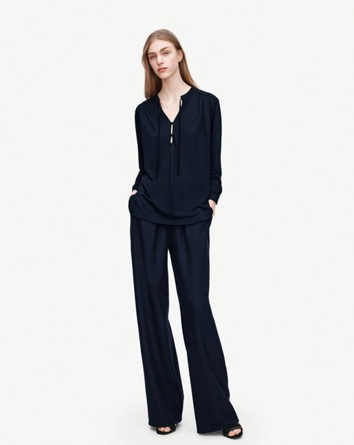 Simple chic everyday blouse in a slightly sheer viscose crepe jersey with tie front detail. Small buttons at front and pleats at shoulders and bottom sleeves for a feminine finish. Wear with raw denim or slacks for an effortless chic day look. <br><br>