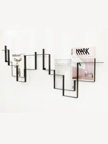 GUIDELINES is a minimalist magazine holder designed by Dutch designer Frederik Roijé.