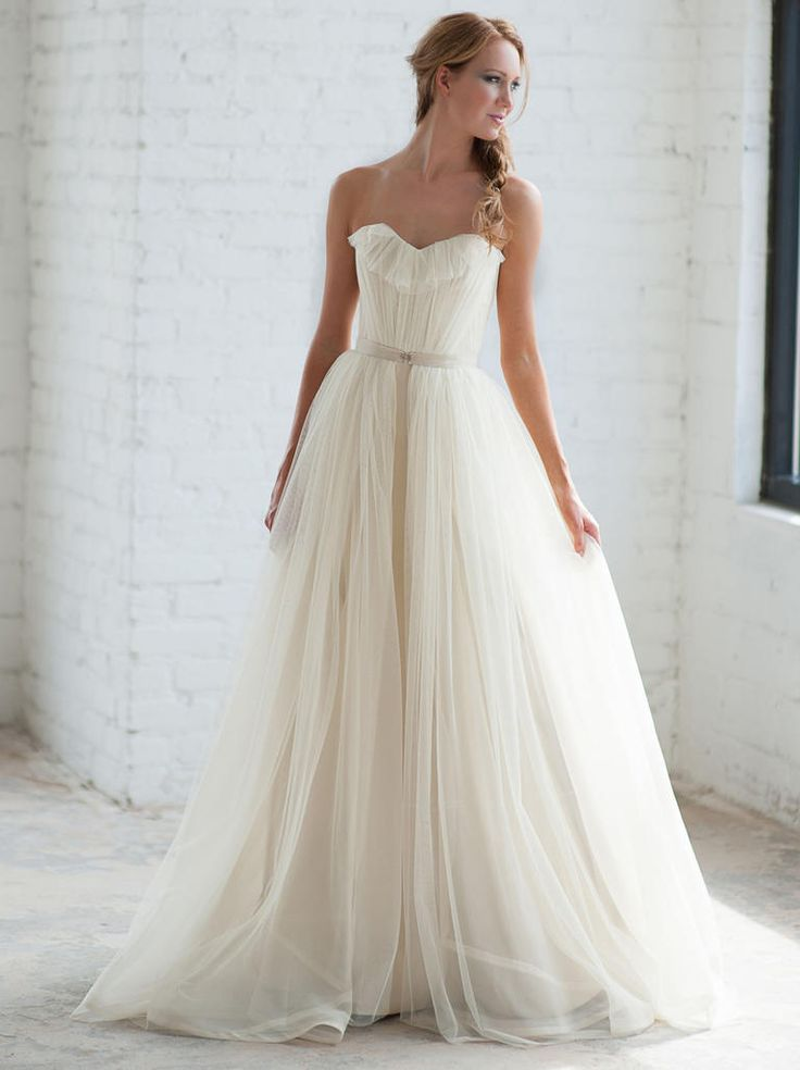 Tara LaTour Fall 2016 white strapless tulle overskirt wedding dress | https://www.theknot.com/content/tara-latour-wedding-dresses-bridal-fashion-week-fall-2016