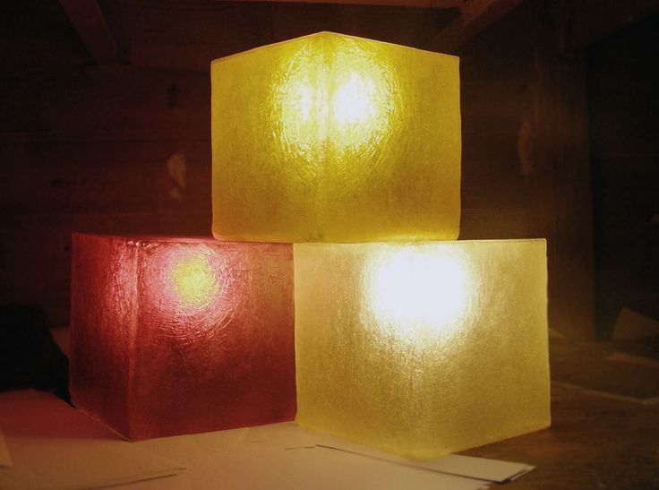 Lighting fixture in the shape of a cube, made out of fiberglass.  Available in three colours: yellow gold, wine red and natural white.For more pics, pleace cut and paste the following links:  Yellow Gold cube -> http://www.gshopspot.gr/product.php?product_id=614  Wine Red cube -> http://www.gshopspot.gr/product.php?product_id=612  Natural White cube -> http://www.gshopspot.gr/product.php?product_id=613