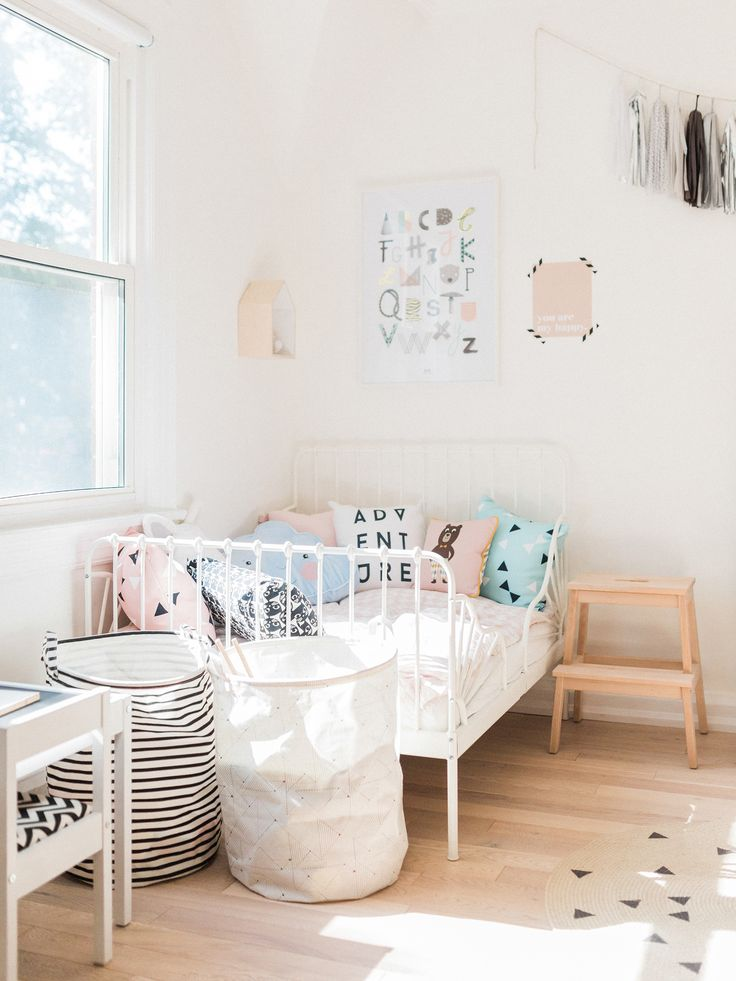 Scandinavian shared kids room - light-filled, pastel baby + toddler playroom - Ikea Minnen bed, House Doctor baskets | Happy Grey Lucky