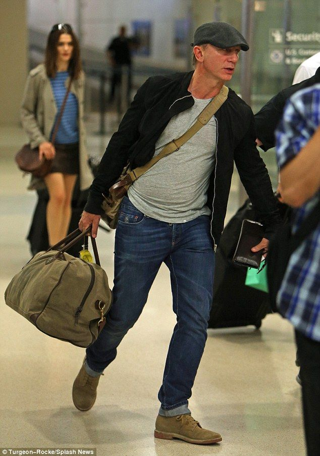 Daniel Craig and Rachel Weisz arrive at airport in New Jersey #dailymail