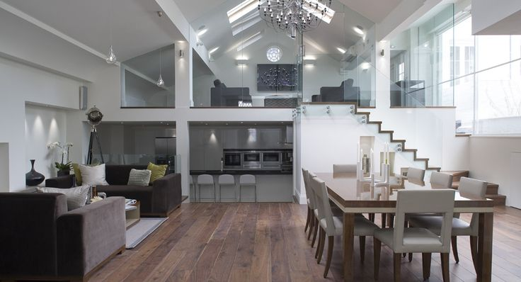 Open Floor Plan Living Room Kitchen Dining Room With Glass Wall Separation Vaulted Ceiling