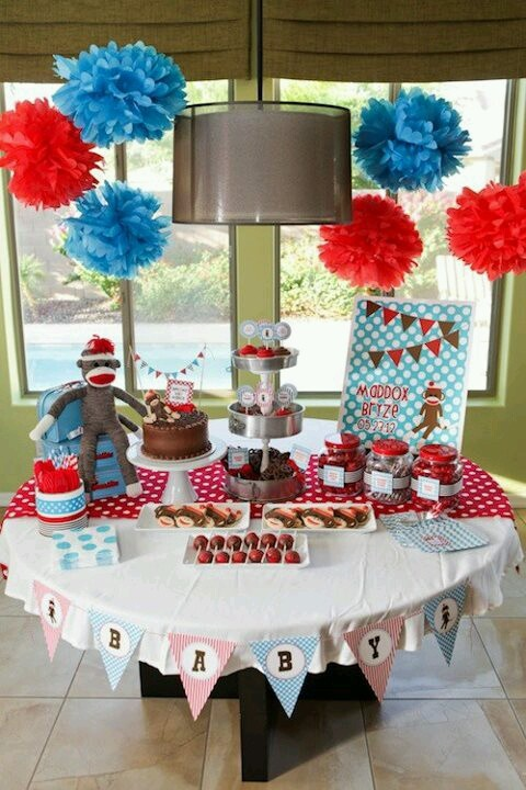 Sock monkey baby shower.. for a boy? It would be easy to get red white and blue decor as well considering it would be a month before 4th of july