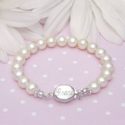 A fine cultured pearl baby bracelet with custom engraving on the sterling silver safety clasp.