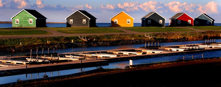 Colorful cottages glow in evening light along the Brule Shore, near Tatamagouche on Nova Scotia's north shore. (©Jim Wilkes photo)