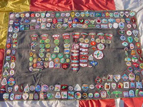 This is a picture taken several years ago of my personal Scouting blanket.  I can't call it a true campfire blanket because at the time I made it I really had never been exposed to the idea of a poncho style that could be worn.  I just wanted to take every patch I ever earned in Scouting and sew them on a blanket.  I'll maybe start a new board as some time to share the story of some of these patches.