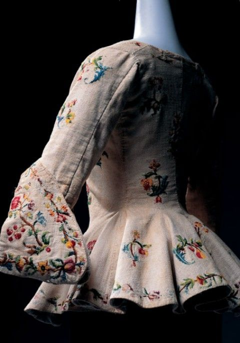 Casaquin, Late 17th Century, Italian. White cotton/linen with polychrome wool embroidery; floral motif; sabot sleeves; with peplum.