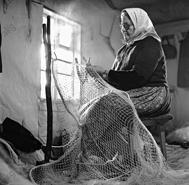 Reparing a net on Kihnu Island. Estonia