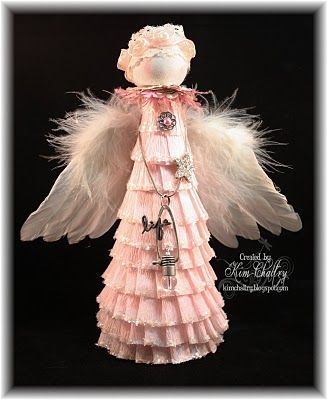 Guardian Angel: I created her by using a cone and hot glued crepe paper in rows as I gathered it. I sprinkled chunky glitter on the edges. Her wings were a Christmas ornament that I cut in half and glued on. Her head is a wooded ball that was painted white and wiped off for a white washed look, and given chalk color to her cheeks. Ribbon Crown and punched musice for collar. Extra embellishments added to taste.