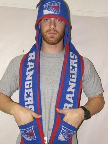 New York Rangers 2011 Team Stripe Hooded Knit Scarf w/ Pockets by Forever Collectibles. $19.50. Keep warm during those brisk fall and winter days while supporting your team in style with this Team Stripe Hooded Knit Scarf from Forever Collectibles! The scarf features your favorite team name and logo, stylish hood, and 2 pockets. Measures approximately 6''x60'' and is made of 100% Acrylic. Officially licensed.. Save 22%!