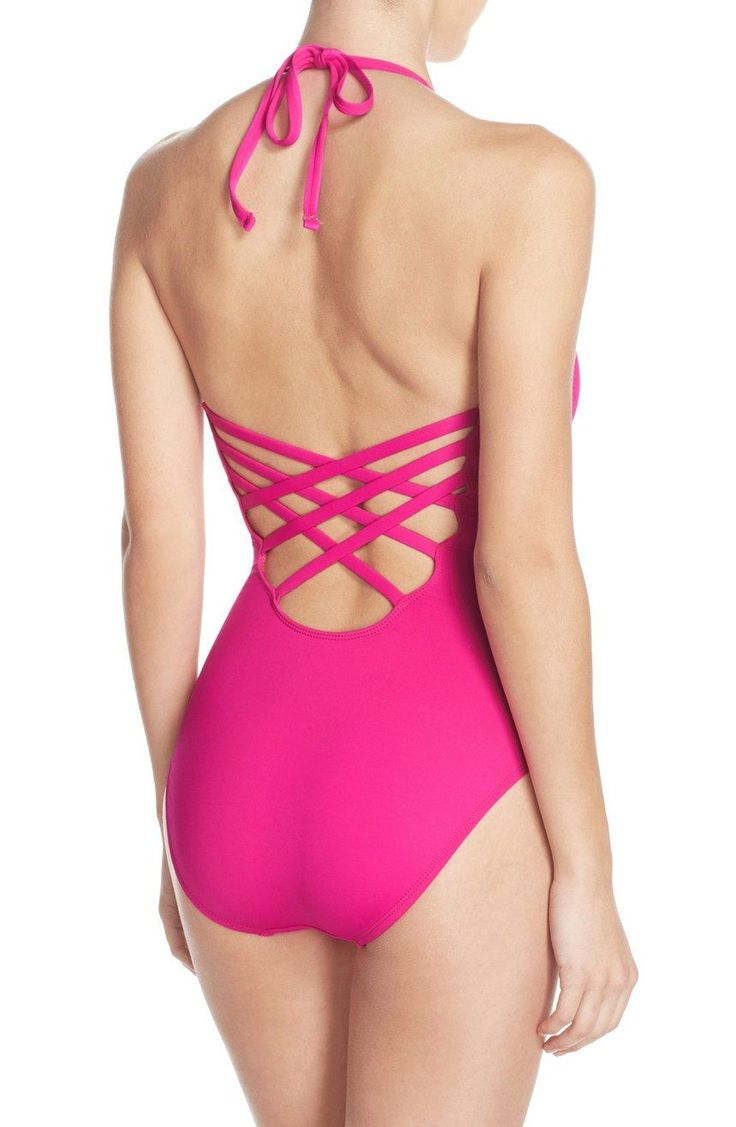 Stand out this season with this bright pink one-piece swimsuit. The straps span the deep-V neck and crisscross at the back to lend sultry dimension to this halter silhouette.
