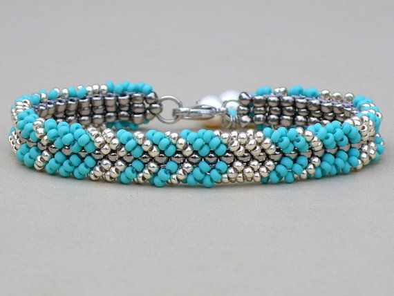 When purchasing use coupon code SAVE20.  Beautiful seed bead bracelet in turquoise blue and silver, embellished with one freshwater pearl at the clasp.