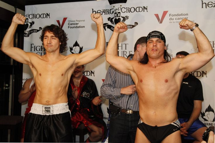Senator Patrick Brazeau, right, and Liberal MP Justin Trudeau take part in a weigh-in for a upcoming boxing match Wednesday March 28, 2012