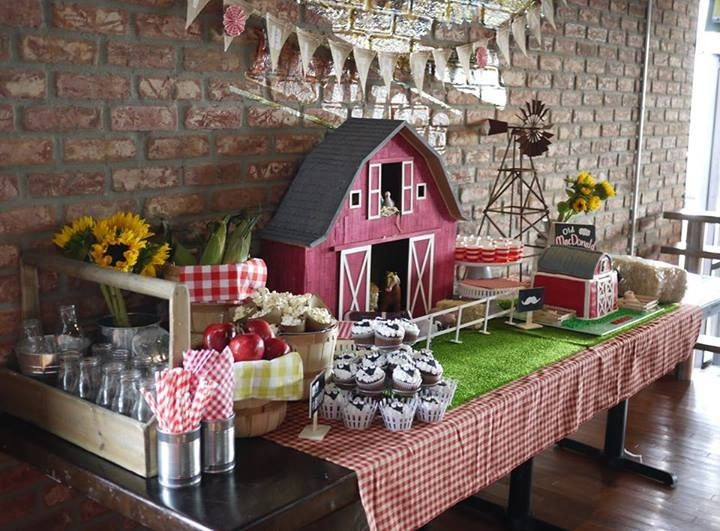 This Farm Fresh 1st Birthday Party was a joy to create. We handmade a red barn and windmill for a beautiful back drop. Added fresh hay, vintage milk bottles, apples and sunflowers to create this tablescape. Custom barn cake, sheep cupcakes, jello, chocolate covered marshmallows and strawberries made for a delicious dessert table. www.bringyoparty.com
